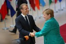 French President Emmanuel Macron greets Germany's Chancellor Angela Merkel as they arrive at an European Union leaders summit in Brussels, Belgium, June 28, 2018. REUTERS/Eva Plevier - RC18630AEA20