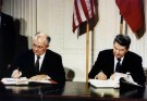 FILE PHOTO 8DEC87 - U.S. President Ronald Reagan (R) and Soviet President Mikhail Gorbachev sign the Intermediate-Range Nuclear Forces (INF) treaty in the White House December 8 1987. Reagan was elected as the 40th U.S. president in 1980.CM - RP2DRHXTDDAC