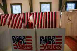 A woman leaves a voting station in a polling place at the Canterbury Town Hall polling station in Canterbury, New Hampshire February 9, 2016. REUTERS/Shannon Stapleton - D1BESMAVHBAB
