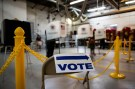 A sign points towards voting booths during the midterm election at Philomont Fire Station, in Purcellville, Virginia, U.S., November 6, 2018. REUTERS/Al Drago - RC1C4591A6A0