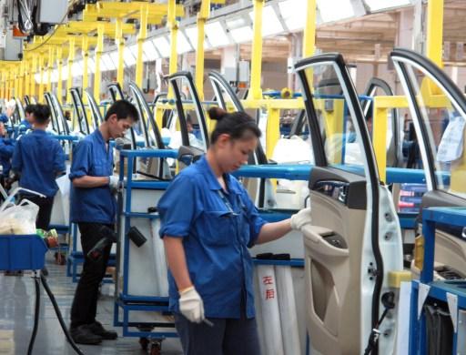 Employees work at a production line inside a factory of Saic GM Wuling, in Liuzhou, Guangxi Zhuang Autonomous Region, China, June 19, 2016. REUTERS/Norihiko Shirouzu - S1AETQJGBJAA