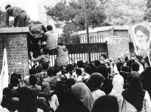 Student protestors climb over the gate to the U.S. Embassy in Tehran on November 4, 1979. / Wikimedia Commons