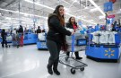 Shoppers leave a Walmart store in Chicago, Illinois, U.S., November 20, 2018. REUTERS/Kamil Krzaczynski - RC131194DA70