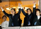 Japan's Prime Minister Shinzo Abe (3rd R), who is also ruling Liberal Democratic Party leader, raises hands with coalition Komeito Party leader Natsuo Yamaguchi atop of campaign van at Tokyo's Shibuya district in Tokyo, Japan September 28, 2017.  REUTERS/Toru Hanai - RC1E5CA0BCF0