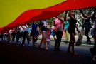 Gay rights activists carry a rainbow flag during the 11th annual March against Homophobia and Transphobia in Havana, Cuba, May 12, 2018. REUTERS/Alexandre Meneghini - RC1CEDDEEF00