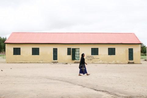 A woman walks past the Hausari primary school in Michika village, northeast Nigeria June 12, 2017. Picture taken June 12, 2017. REUTERS/Akintunde Akinleye - RC1AFAC79A10