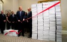 U.S. President Donald Trump cuts a red tape while speaking about deregulation at the White House in Washington, U.S., December 14, 2017. REUTERS/Kevin Lamarque - RC1D5597AAF0