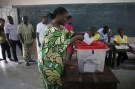 A woman casts her vote during a presidential election at a polling station in Cotonou Benin, March 6, 2016. REUTERS/Akintunde Akinleye - GF10000335330