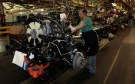 FILE PHOTO: General Motors auto assembly worker Karen Garner works on assembling engines for Chevrolet Silverado's and GMC Sierra pickup trucks at the Flint Assembly in Flint, Michigan January 24, 2011.  REUTERS/Rebecca Cook/File Photo - RC1C42526E40