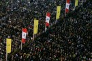 Lebanon's Hezbollah supporters take part in a rally marking Resistance and Liberation Day in Beirut May 25, 2009, commemorating the anniversary of Israel's withdrawal from southern Lebanon in 2000.  REUTERS/Issam Kobeisy   (LEBANON POLITICS ANNIVERSARY) - GM1E55Q09RQ01
