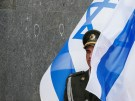 Israeli national flag covers a soldier from Ukraine's honour guards during a welcoming ceremony for Israeli President Reuven Rivlin in Kiev, Ukraine, September 27, 2016.  REUTERS/Gleb Garanich - D1BEUDSPOQAA