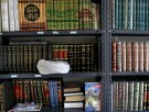 Iranian cleric Ayatollah Sepehr Norouzi's turban rests on a shelf in the library of his home in Tehran July 31, 2005. REUTERS/Morteza Nikoubazl  CJF/SN - RP6DRMTRWOAB