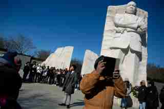"""Brandon Stanard, 24, a student at Lincoln University, recites Martin Luther King, Jr.'s """"I have a dream"""" speech to a gathering crowd at the base of a statue of the civil rights leader at the Martin Luther King, Jr. Memorial on Martin Luther King Jr. Day in Washington, U.S., January 21, 2019. REUTERS/Allison Shelley     TPX IMAGES OF THE DAY - RC1FB437CDE0"""