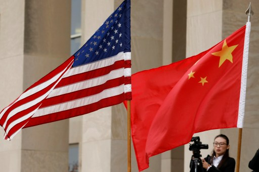 U.S. and Chinese flags are seen before Defense Secretary James Mattis welcomes  Chinese Minister of National Defense Gen. Wei Fenghe to the Pentagon in Arlington, Virginia, U.S., November 9, 2018. REUTERS/Yuri Gripas - RC138EB22270