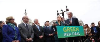 "U.S. Representative Alexandria Ocasio-Cortez (D-NY) and Senator Ed Markey (D-MA) hold a news conference for their proposed ""Green New Deal"" to achieve net-zero greenhouse gas emissions in 10 years, at the U.S. Capitol in Washington, U.S. February 7, 2019.  REUTERS/Jonathan Ernst - RC1FD2ED6050"