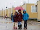 Syrian refugee children walk in Elbeyli refugee camp near the Turkish-Syrian border in Kilis province, Turkey, December 1, 2016. REUTERS/Umit Bektas - RC138BB33480