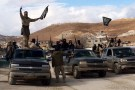 Al Qaeda-linked Nusra Front fighters carry weapons on the back of pick-up trucks during the release of Lebanese soldiers and policemen in Arsal, eastern Bekaa Valley, Lebanon, December 1, 2015.  REUTERS/Stringer      TPX IMAGES OF THE DAY      - GF200000812722