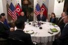 U.S. President Donald Trump and North Korean leader Kim Jong Un sit down for a dinner during the second U.S.-North Korea summit at the Metropole Hotel in Hanoi, Vietnam February 27, 2019. Also pictured at right are U.S. Secretary of State Mike Pompeo and Acting White House Chief of Staff Mick Mulvaney, at left are Vice Chairman of the North Korean Workers' Party Central Committee Kim Yong Chol and North Korea's Foreign Minister Ri Yong Ho (obscured)   REUTERS/Leah Millis - RC179F888B20