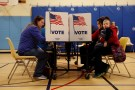 Voters cast their ballots on Election Day at Washington Mill Elementary School in Alexandria, Virginia, U.S., November 7, 2017. REUTERS/Aaron P. Bernstein - RC1FB1A295B0