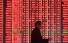 A man is seen in front of an electronic board showing stock information on the first day of trading in the Year of the Pig, following the Chinese Lunar New Year holiday, at a brokerage house in Hangzhou, Zhejiang province, China February 11, 2019. REUTERS/Stringer ATTENTION EDITORS - THIS IMAGE WAS PROVIDED BY A THIRD PARTY. CHINA OUT.
