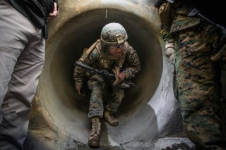 U.S. Marine Corps Lance Corporal Alberto Ramirez utilizes a communication system while underground during Urban Advanced Naval Technology Exercise 2018 (ANTX18) at Marine Corps Base Camp Pendleton, California, U.S. March 19, 2018. Picture taken March 19, 2018. U.S. Marine Corps/Lance Cpl. Rhita Daniel/Handout via REUTERS.   ATTENTION EDITORS - THIS IMAGE WAS PROVIDED BY A THIRD PARTY - RC13A748CBD0