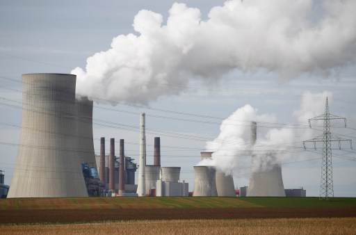 Steam rises from the five brown coal-fired power units of RWE, one of Europe's biggest electricity companies in Neurath, north-west of Cologne, Germany March 12, 2019. REUTERS/Wolfgang Rattay - RC1E5D3C6B40