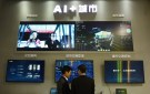 Men visit iFlytek's artificial intelligence (AI) smart city display at the International Intelligent Transportation Industry Expo in Hangzhou, Zhejiang province, China December 21, 2018. REUTERS/Stringer  ATTENTION EDITORS - THIS IMAGE WAS PROVIDED BY A THIRD PARTY. CHINA OUT. - RC1E35A070C0