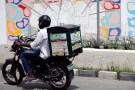 A man rides a motorbike with a delivery box along a road in Ajose Adeogun district in Victoria Island, Lagos, Nigeria June 4, 2018. Picture taken June 4, 2018. REUTERS/Akintunde Akinleye - RC1C91FE5F80