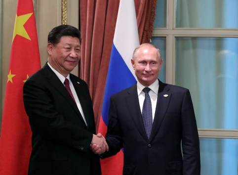 Russia's President Vladimir Putin (R) shakes hands with China's President Xi Jinping during a meeting on the sidelines of the G20 summit in Buenos Aires, Argentina November 30, 2018. Picture taken November 30, 2018. Sputnik/Mikhail Klimentyev/Kremlin via REUTERS  ATTENTION EDITORS - THIS IMAGE WAS PROVIDED BY A THIRD PARTY. - RC1AB6752940