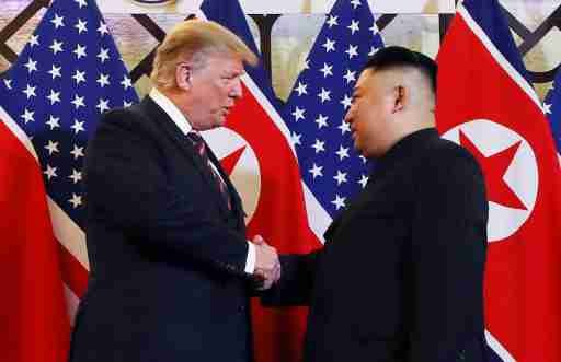 U.S. President Donald Trump and North Korean leader Kim Jong Un shake hands before their one-on-one chat during the second U.S.-North Korea summit at the Metropole Hotel in Hanoi, Vietnam February 27, 2019. REUTERS/Leah Millis     TPX IMAGES OF THE DAY - RC16A5993080