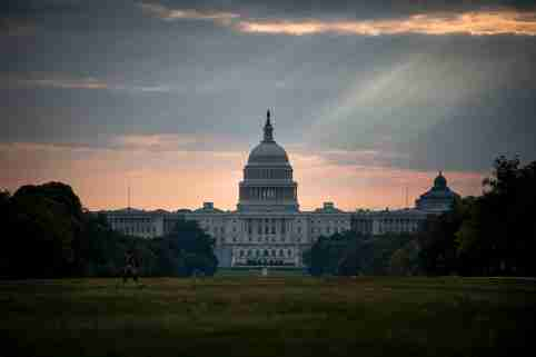 The U.S. Capitol building is seen on Tuesday morning after the federal government was shutdown when the House and Senate failed to pass a budget in Washington October 1, 2013. The lawmakers who shut down the U.S. government on Tuesday have the best view of the result from their perch in the U.S. Capitol: a two-mile stretch of museums, monuments and federal buildings along the National Mall that were closed for business. REUTERS/James Lawler Duggan   (UNITED STATES - Tags: POLITICS BUSINESS) - GM1E9A11QZF01