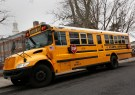 A school bus used for transporting New York City public school students is seen parked in front of a school in the Queens borough of New York January 15, 2013. New York City school bus drivers will go on strike on Wednesday, an action that Mayor Michael Bloomberg said would complicate the commute of more than 152,000 students in the nation's largest public school system. REUTERS/Shannon Stapleton (UNITED STATES - Tags: EDUCATION) - GM1E91G074101