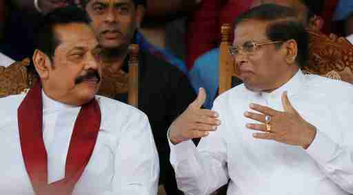 Sri Lanka's newly appointed Prime Minister Mahinda Rajapaksa and President Maithripala Sirisena talk during a rally near the parliament in Colombo, Sri Lanka November 5, 2018. REUTERS/Dinuka Liyanawatte - RC1F3E67FE20