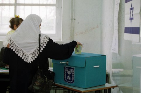 An Israeli-Arab voter drops a ballot into a ballot box during voting in East Jerusalem, February 6, 2001. Most Israeli-Arabs are expected to abstain from voting in a protest against the 13 Israeli-Arabs who were killed during the recent 'Intifada' or uprising against Israel. Ariel Sharon appeared poised for a stunning political victory over Prime Minister Ehud Barak as voters began casting ballots Tuesday in an election seen as a referendum on Israel's relationship with the Palestinians.EH/WS - RP2DRIGVXBAA