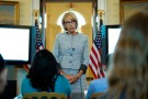 U.S. Secretary of Education Betsy DeVos speaks with school children during a listening session before the arrival of U.S. first lady Melania Trump at the White House in Washington, U.S., April 9, 2018. REUTERS/Joshua Roberts - RC14E35B0270
