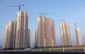 Residential buildings under construction are seen in Jinpu New District in Dalian, Liaoning province, China March 19, 2018. China Daily via REUTERS   ATTENTION EDITORS - THIS IMAGE WAS PROVIDED BY A THIRD PARTY. CHINA OUT. NO COMMERCIAL OR EDITORIAL SALES IN CHINA. - RC16EF764510