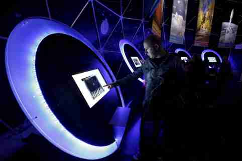 A visitor uses a touchscreen inside a dome during a European Space Expo, running under the auspices of the European Commission in Athens' Syntagma Square, March 28, 2015. REUTERS/Kostas Tsironis - GF10000041752