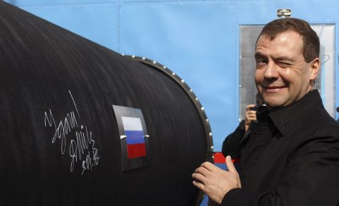 Russian President Dmitry Medvedev gestures after writing 'Good Luck!' on a pipe of the Nord Stream pipeline near Russian town of Vyborg, April 9, 2010. Medvedev took part in the ceremony on Friday to start building the pipeline, which was designed to help Russia increase its influence in EU gas markets from the current 25 percent to about a third.  REUTERS/Alexander Demianchuk  (RUSSIA - Tags: POLITICS ENERGY BUSINESS) - GM1E6491EYC01
