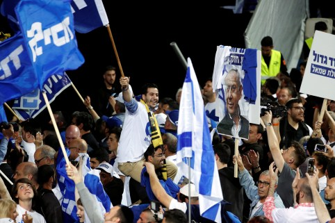 Supporters of Israeli Prime Minister Benjamin Netanyahu's Likud party react to exit polls in Israel's parliamentary election at the party headquarters in Tel Aviv, Israel April 10, 2019. REUTERS/Ronen Zvulun - RC1E78CE7370