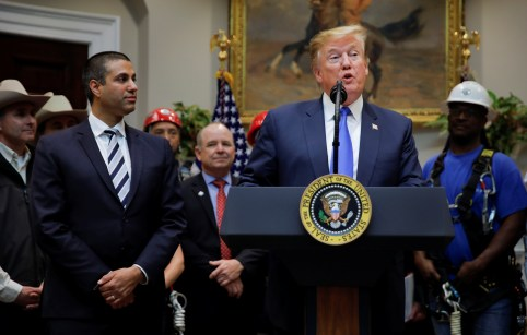 U.S. President Donald Trump speaks next to Federal Communications Commission (FCC) Commissioner Ajit Pai during an event on United States 5G deployment in the Roosevelt Room of the White House in Washington, U.S., April 12, 2019. REUTERS/Carlos Barria - RC19EF413F60