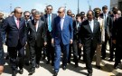 Turkish President Tayyip Erdogan (C) walks alongside Somalia's President Hassan Sheikh Mohamud (R) and other unidentified officials during the opening ceremony of the new Turkish embassy in Abdiazizi district of Somalia's capital Mogadishu, June 3, 2016. REUTERS/Feisal Omar - S1AETHUSPPAA
