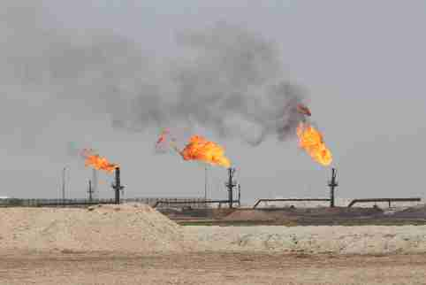 Flames emerge from the flare stacks at the West Qurna-1 oilfield, which is operated by Exxon Mobil, near Basra, Iraq, May 20, 2019. Picture taken May 20, 2019. REUTERS/Essam Al-Sudani - RC1D78173900