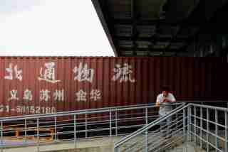 A truck driver waits at a logistics area of the Shanghai Free Trade Zone, in Shanghai.