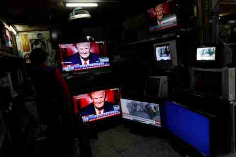 Images of U.S. President Donald Trump are seen on TV screens at a second hand shop in Taipei,Taiwan January 21, 2017. REUTERS/Tyrone Siu - RC1DB4686E10