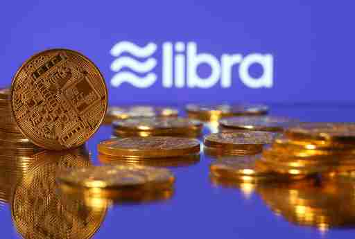Representations of virtual currency are displayed in front of the Libra logo in this illustration picture, June 21, 2019. REUTERS/Dado Ruvic/Illustration - RC141DEAAD20