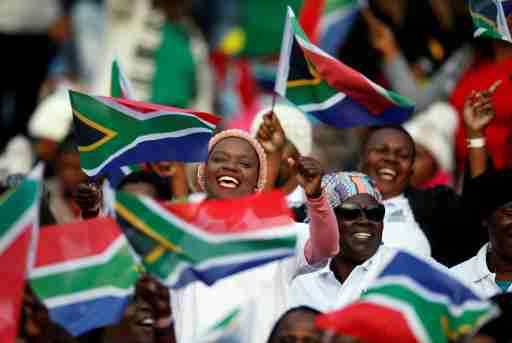 Guests sing as they arrive for the inauguration of Cyril Ramaphosa as President, at Loftus Versveld stadium in Pretoria, South Africa, May 25, 2019. REUTERS/Siphiwe Sibeko - RC17E4818CD0