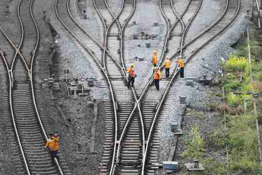Workers inspect railway tracks, which serve as a part of the Belt and Road freight rail route linking Chongqing to Duisburg, at Dazhou railway station in Sichuan province, China March 14, 2019. Picture taken March 14, 2019.  REUTERS/Stringer ATTENTION EDITORS - THIS IMAGE WAS PROVIDED BY A THIRD PARTY. CHINA OUT. - RC1563D032A0