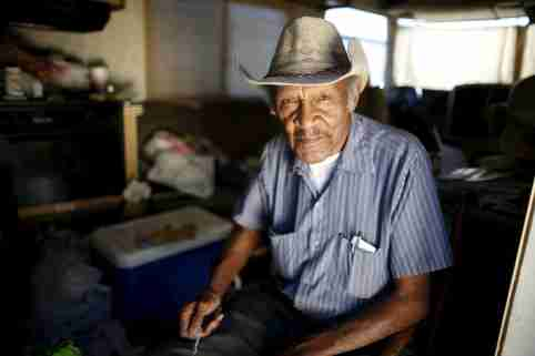 "Samuel Cole, 85, poses for a portrait in the motorhome in which he lives on the streets of Los Angeles, California, United States, November 12, 2015. Cole is a retired truck driver who began living in his motorhome two years ago when he couldn't afford the $100 rise in his rent. Los Angeles is grappling with a massive homelessness problem, as forecasted El Nino downpours threaten to add to the misery of thousands of people who sleep on the streets. Mayor Eric Garcetti has proposed spending $100 million to combat the problem in the sprawling metropolis but stopped short of declaring a state of emergency. REUTERS/Lucy Nicholson PICTURE 8 OF 17 - SEARCH ""NICHOLSON MOTORHOME"" FOR ALL IMAGES   TPX IMAGES OF THE DAY            - GF10000270548"