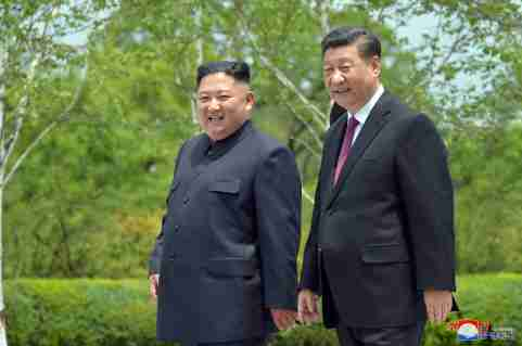 Chinese President Xi Jinping and North Korean leader Kim Jong Un walk during Xi's visit in Pyongyang, North Korea in this picture released by by North Korea's Korean Central News Agency (KCNA) on June 21, 2019.    KCNA via REUTERS    ATTENTION EDITORS - THIS IMAGE WAS PROVIDED BY A THIRD PARTY. REUTERS IS UNABLE TO INDEPENDENTLY VERIFY THIS IMAGE. NO THIRD PARTY SALES. SOUTH KOREA OUT. NO COMMERCIAL OR EDITORIAL SALES IN SOUTH KOREA. - RC1347120C00