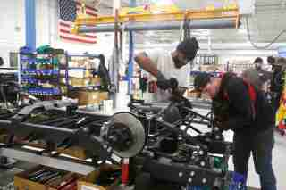 Mahindra Automotive North America assembly workers DeAndre Hall (L) and Ryan Hart work on the chassis for a ROXOR off-road vehicle at the MANA assembly plant in Auburn Hills, Michigan, U.S., January 30, 2019.  Photo taken January 30, 2019.    REUTERS/Rebecca Cook - RC145CDD5E30